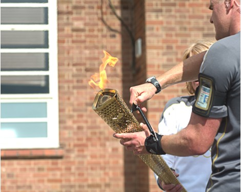 Switching off the Olymic Flame from the final torch on the Cromer leg of the Olmpic Torch relay