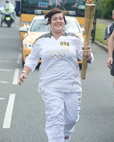 Jodie Andrews participating in the Olympic Torch relay in Cromer, North Norfolk