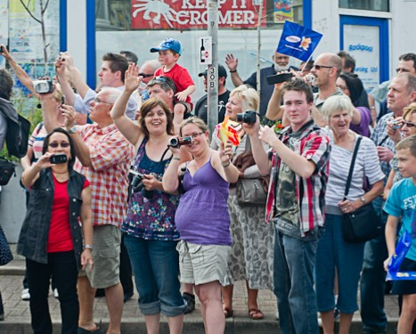 Crowds photographing the Media One bus following the Olympic Torch relay in Cromer, North Norfolk