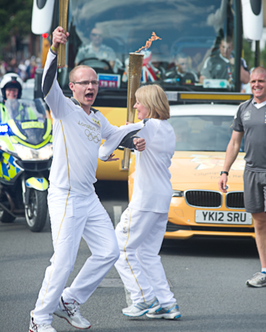 Nicky Wardale having an Olympic jig with Harry Heathfield during the Olympic Torch relay in Cromer, North Norfolk