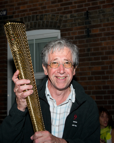 Pierre Butikofer (North Norfolk photographer) holding the Olympic torch