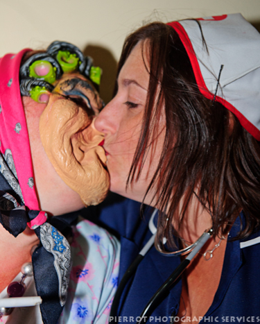 Cromer carnival fancy dress nurse kissing old woman
