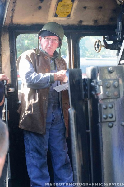 Train driver on locomotive with military helmet at the 1940s weekend in Sheringham