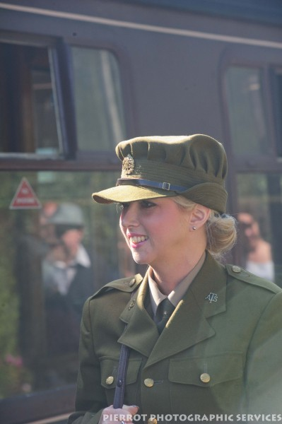 Woman in military uniform at the 1940s weekend in Sheringham, North Norfolk 2012