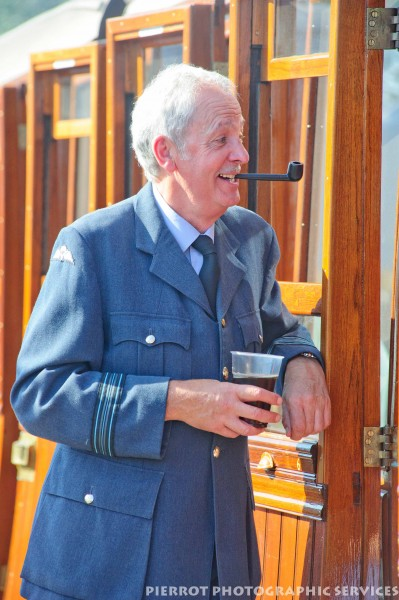 Man in RAF uniform with pipe at the 1940s weekend in Sheringham, North Norfolk 2012