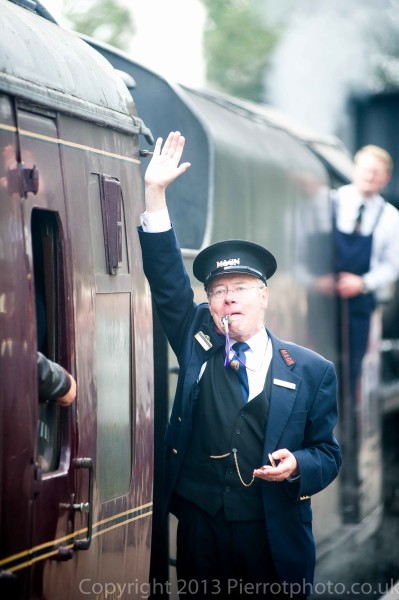 Station master on the platform