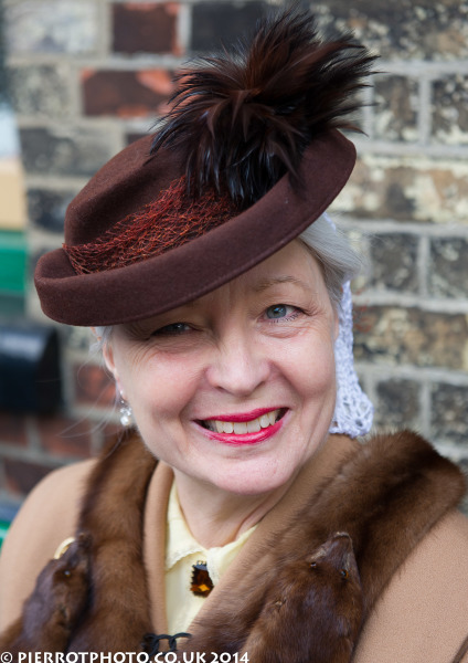 1940s weekend in Sheringham North Norfolk 2014 - woman in brown felt hat and fox stole