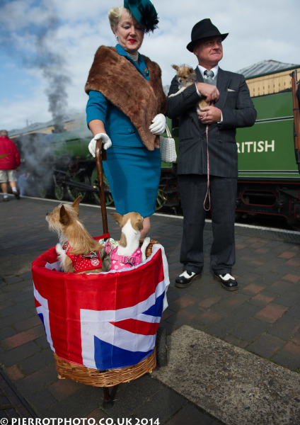 1940s weekend in Sheringham North Norfolk 2014 - man in hat carrying dog