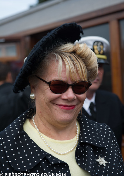 1940s weekend in Sheringham North Norfolk 2014 - woman in polka dot jacket and blue hat