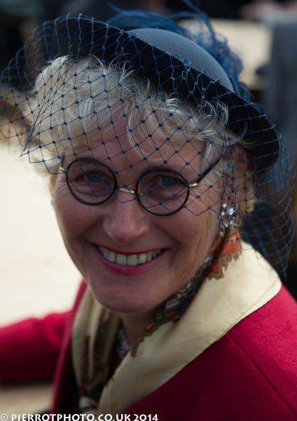 1940s weekend in Sheringham North Norfolk 2014 - woman in blue hat and veil