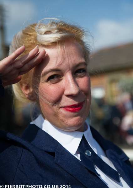 1940s weekend in Sheringham North Norfolk 2014 - attractive woman saluting