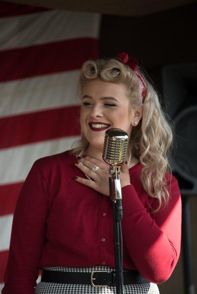 1940s weekend in Sheringham North Norfolk 2017. 1940s singer in red dress