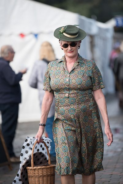 1940s weekend in Sheringham North Norfolk 2017. Mature woman carrying basket on platform