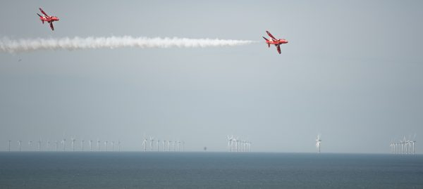 Two Red Arrows flying with Sheringham shoal in the background at Cromer carnival
