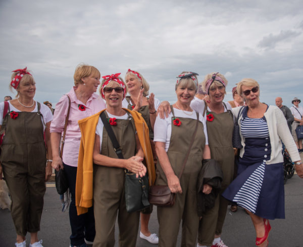 A group of land girls at the seaside at Sheringhamm 1940s weekend