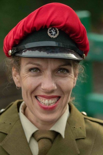Woman with fantastic smile wearing army uniform at Sheringham 1940s weekend