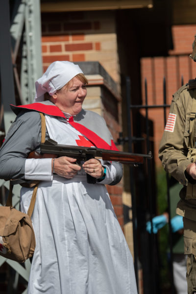 1940s nurse pointing machine gun at Sheringham 1940s weekend